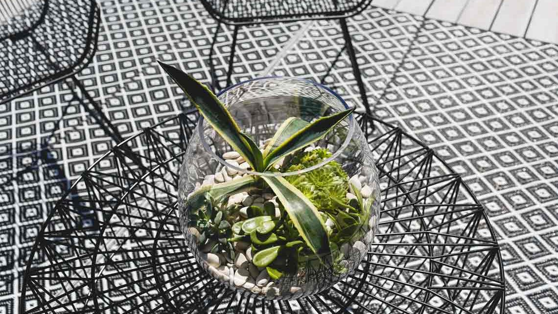 Greenery and outdoor balcony furniture